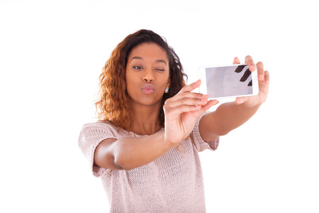 brazilian caribbean: Young African American woman taking a selfie Stock Photo