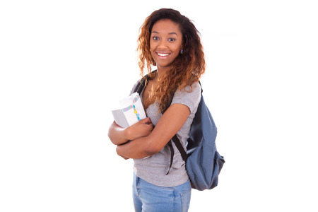 colegios: Muchacha africana estudiante estadounidense que sostiene los libros