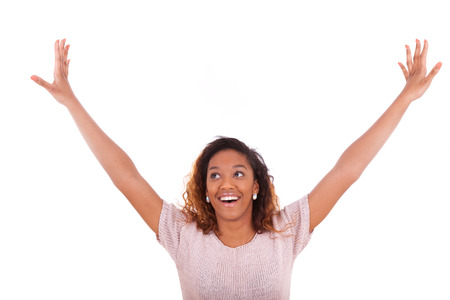 latinamerican: Successful african american woman with arms up expressing her joy  - Black people