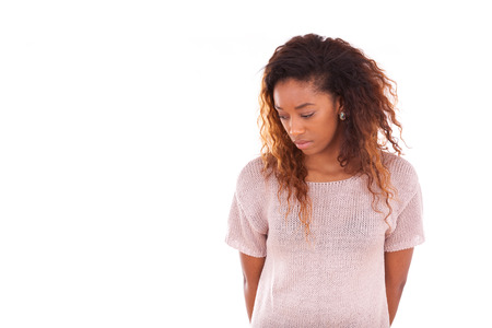 anxiety: Portrait of a thoughtful young african american woman