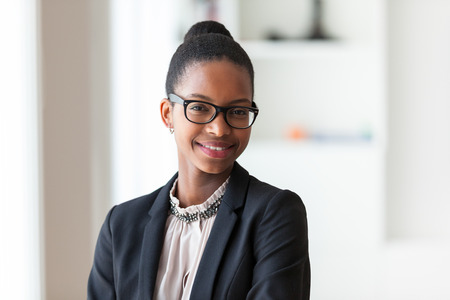 woman close up: Portrait of a young African American business woman - Black people Stock Photo