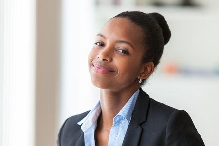 to work: Portrait of a young African American business woman - Black people Stock Photo