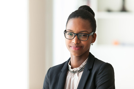 african american woman smiling: Portrait of a young African American business woman - Black people Stock Photo
