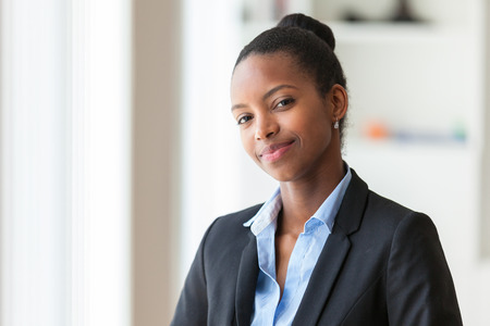 african american businesswoman: Portrait of a young African American business woman - Black people Stock Photo