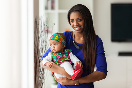 south american ethnicity: Young african american mother holding with her baby girl Stock Photo
