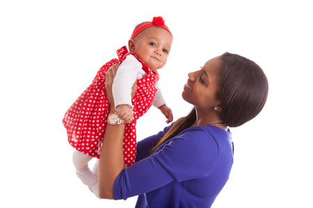 afro caribbean: Young african american mother playing with her baby girl Stock Photo