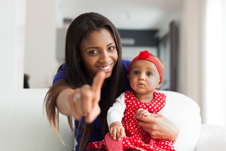 afro caribbean ethnicity: Young african american mother playing with her baby girl Stock Photo