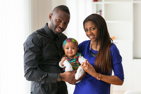 african mother: Portrait of a young african american  couple with her baby girl Stock Photo