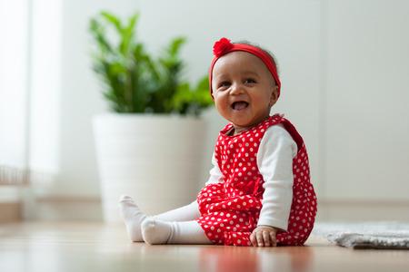 Portrait of little African American little girl smiling - Black people