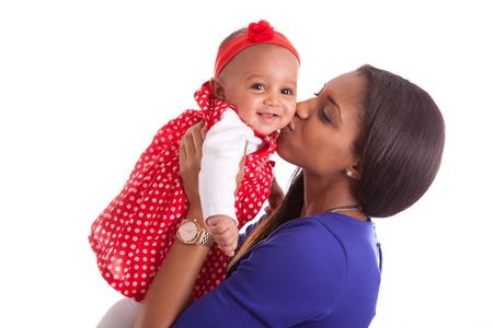 newborn baby mother: Young african american mother playing with her baby girl Stock Photo