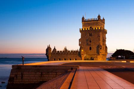 torre: Belem tower - Torre de Belem at night in Lisbon, Portugal Stock Photo