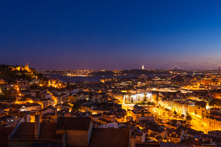 senhora: Aerial view of Lisbon rooftop from Senhora do Monte viewpoint (Miradouro)  by night in Portugal