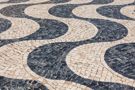 undulation: Typical portuguese cobblestone hand-made pavement calçada in Lisbon, Portugal