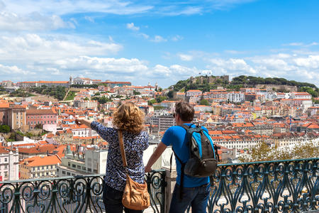portugal: Tourist watching to Lisbon rooftop from Sao Pedro de Alcantara viewpoint - Miradouro in Portugal