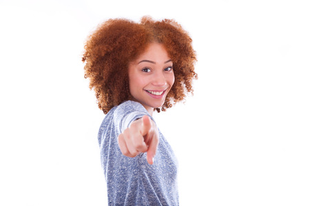latinamerican: Young african american teenage girl pointing finger to the screen, isolated on white background - black people