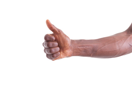 brazilian caribbean: African american hand making thumbs up gesture - Black people Stock Photo