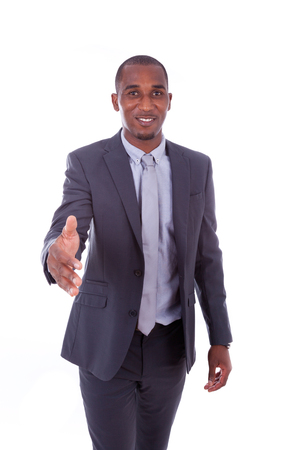 african american handshake: Portrait of a young African American business man greeting with a handshake gesture - Black people