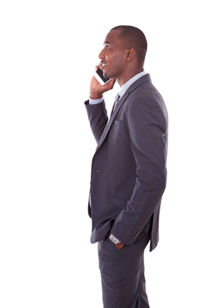 mobile business: Portrait of a young African American business man making a mobile  phone call - Black people