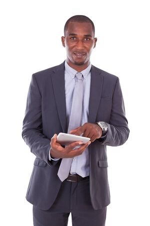 tactile: African american business man using a tactile tablet over white background - Black people