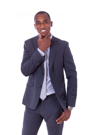 solution: African american business man over white background - Black people