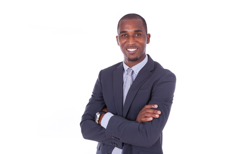 African american business man with folded arms over white background - Black people Stock Photo
