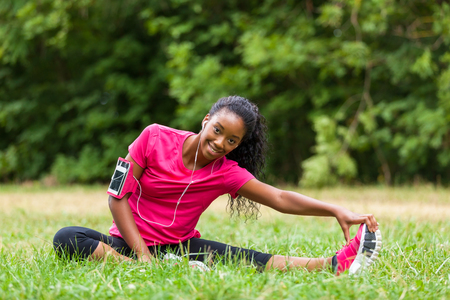 African american woman jogger stretching  - Fitness, people and healthy lifestyle Standard-Bild