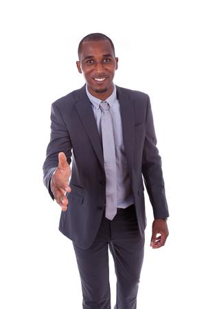 personas saludandose: Retrato de un joven hombre de negocios estadounidense saludo con un gesto apretón de manos - los negros Foto de archivo