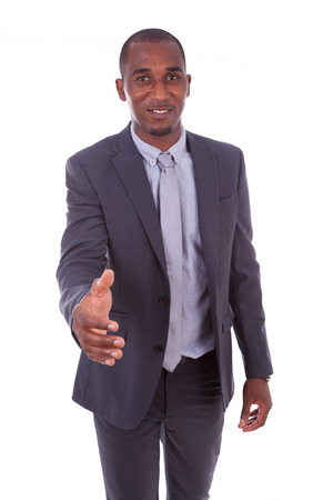 black hands: Portrait of a young African American business man greeting with a handshake gesture - Black people