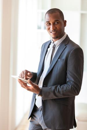 african business man: African american business man using a tactile tablet  - Black people