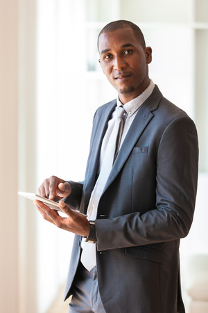 using tablet: African american business man using a tactile tablet  - Black people
