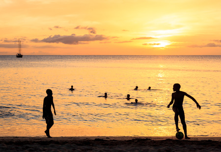 santiago cape verde: Childrens silhouette playing soccer at Tarrafal beach in Santiago island in Cape Verde - Cabo Verde Stock Photo