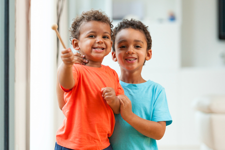 brother: African american brothers child playing together
