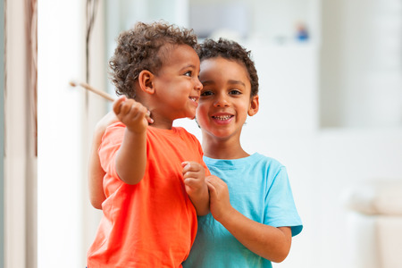 mixed race baby: African american brothers child playing together