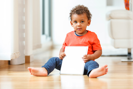 brazilian caribbean: African american little boy using a tactile tablet