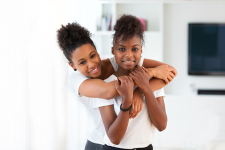 African American best friends portrait hugging - Black people