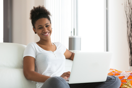 young adults: African American student girl using a laptop computer - black people Stock Photo