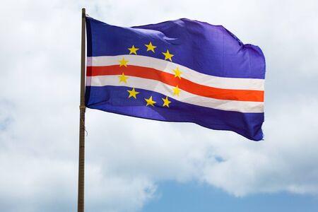 cape verde flag: Cape verde flag waving on wind over a cloudy sky