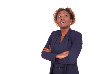 black lady: African American woman with folded arms looking up , isolated on white background - Black people Stock Photo