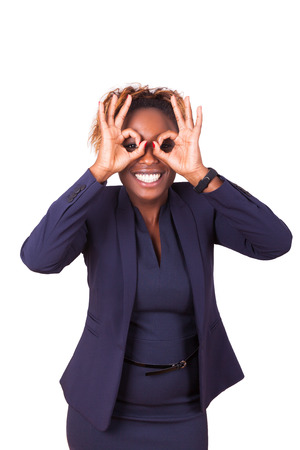 executive search: African American business woman making binocular gesture with her hands - Black people