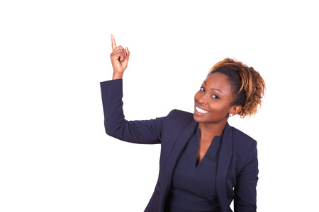 pointing finger up: African American business woman pointing something up - Black people Stock Photo