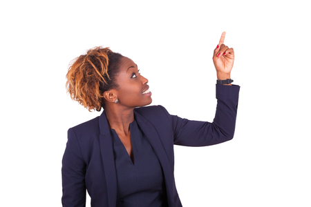 African American business woman pointing something up - Black people Foto de archivo