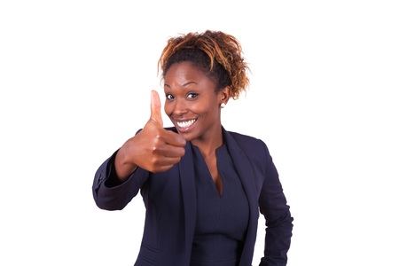 african american businesswoman: African American business woman making thumbs up gesture - Black people