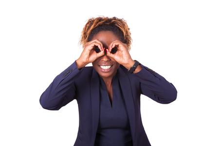 black lady: African American business woman making binocular gesture with her hands - Black people