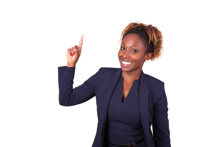 African American business woman pointing something up - Black people Stock Photo