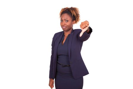 disappointed: African American business woman making thumbs down gesture, isolated on white background