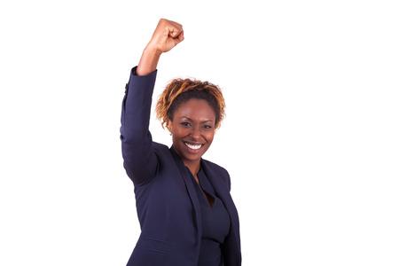 personas festejando: Mujer de negocios del afroamericano con el puño cerrado, aislado en fondo blanco Foto de archivo