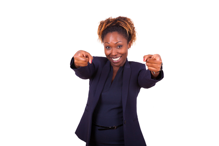 designate: African American business woman pointing fingers to the screen, isolated on white background Stock Photo