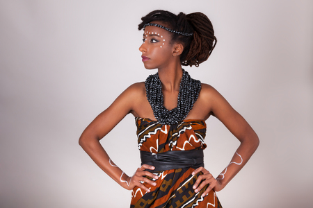 traditional clothes: Young beautiful african woman wearing  traditional clothes and jewelry