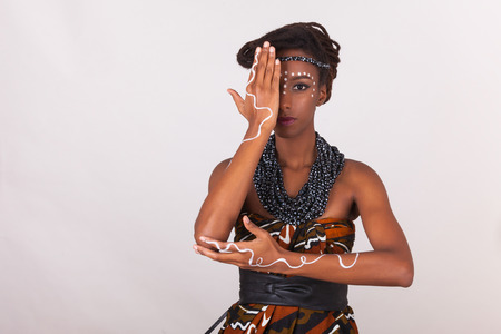 body jewelry: Young beautiful african woman wearing  traditional clothes and jewelry