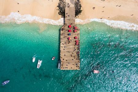 aerial: Aerial view of Santa Maria beach pontoon in Sal Island Cape Verde - Cabo Verde Stock Photo